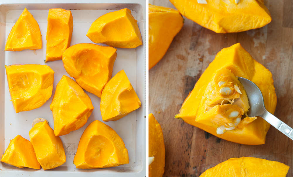 Pumpkin cut into pieces on a white baking sheet. Scooping out the pumpkin seeds with a spoon.