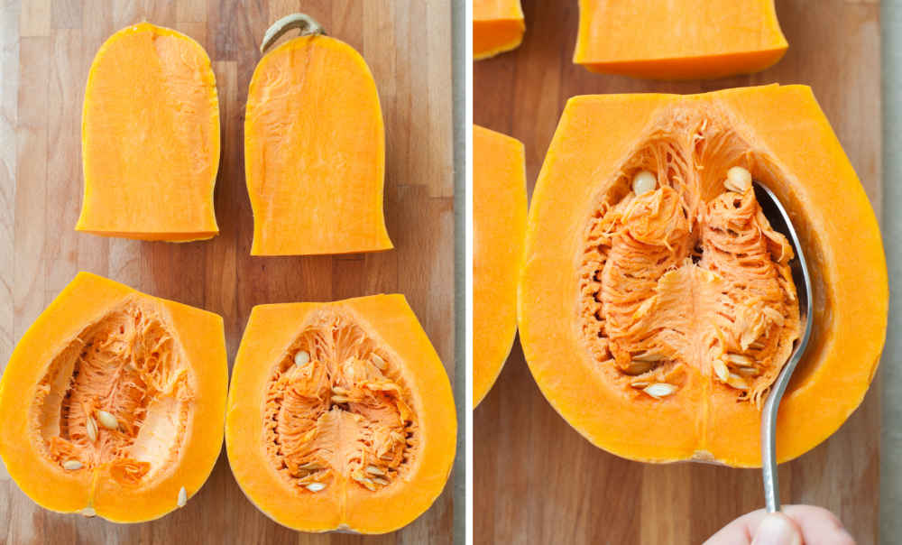 Cut into 4 pieces butternut squash on a chopping board. Scooping out the butternut squash seeds with a spoon.