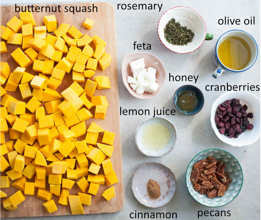 ingredients needed to prepare roasted butternut squash with cranberries, rosemary, pecans, and feta
