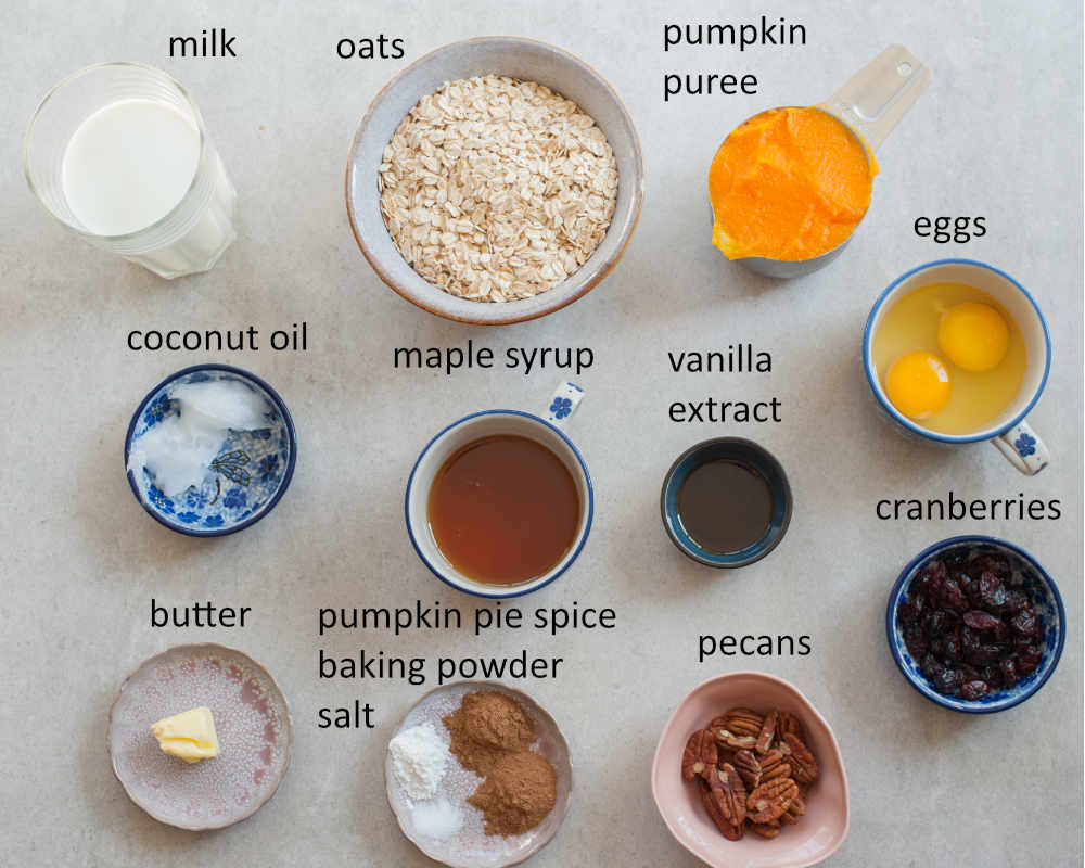 Labeled ingredients needed to prepare baked pumpkin oatmeal.