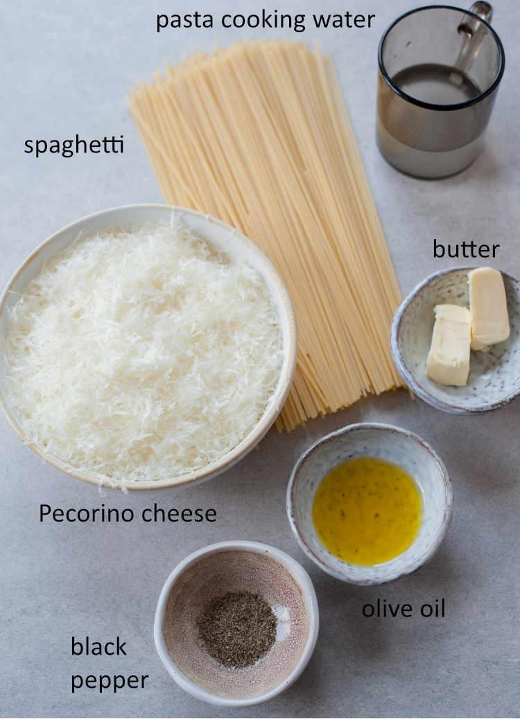 Ingredients needed to prepare spaghetti cacio e pepe.