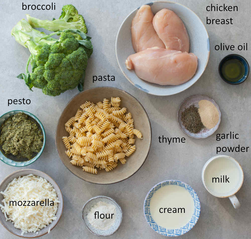 Ingredients needed to prepare pesto chicken bake with pasta and broccoli.