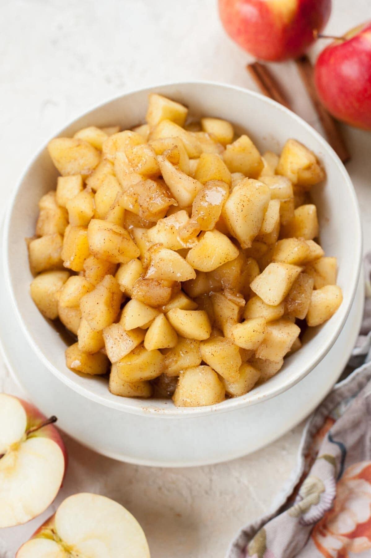 Sautéed Cinnamon Apples in a white bowl.