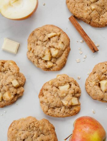 Apple cinnamon oatmeal cookies on a white background. Apples, cinnamon stick, oats on the side.