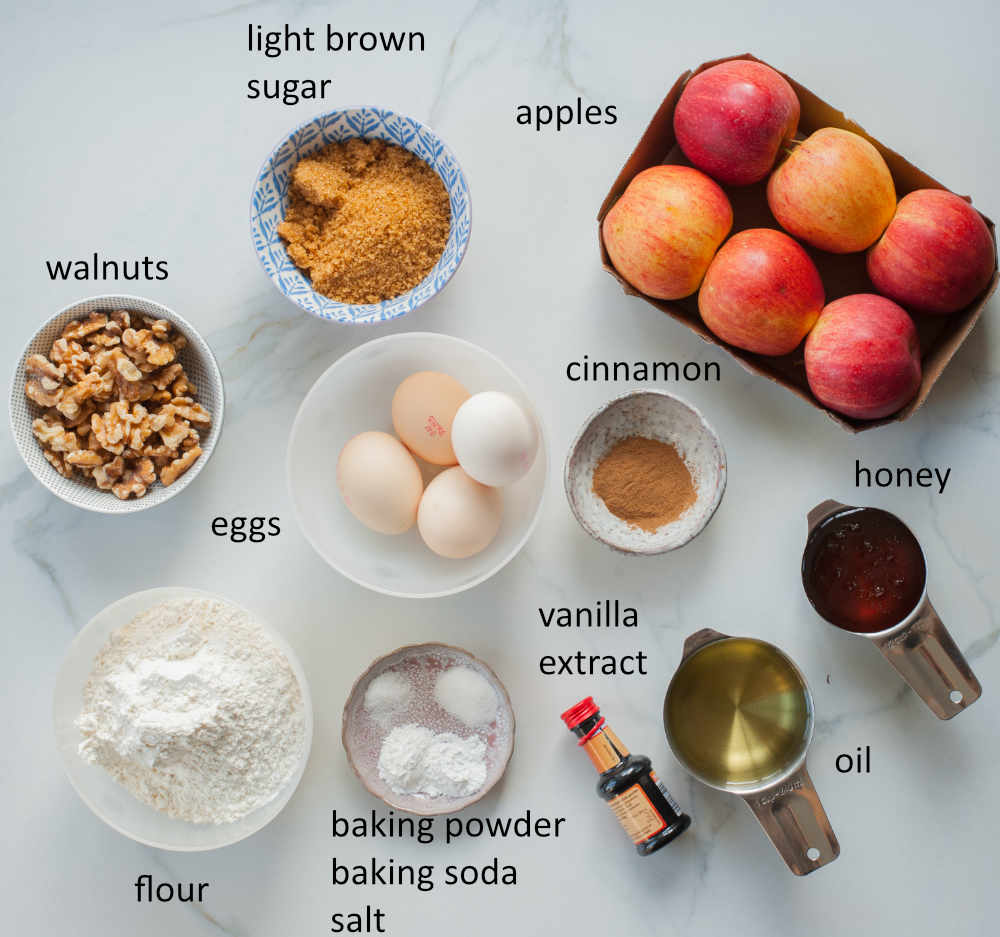 Labeled ingredients needed to prepare apple walnut cake with honey.