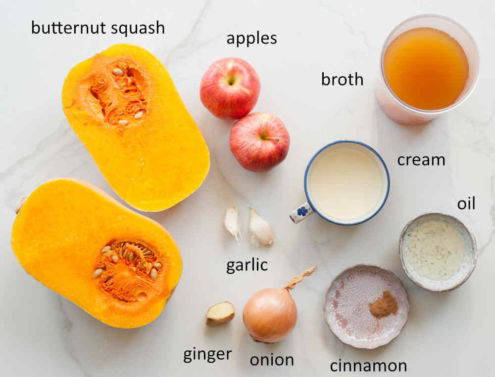 Labeled ingredients needed to prepare butternut squash apple soup.