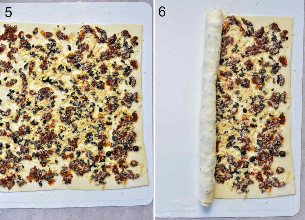 Sun-dried tomato, cheese, and olive filling spread on a puff pastry sheet. Puff pastry sheet is being rolled up.