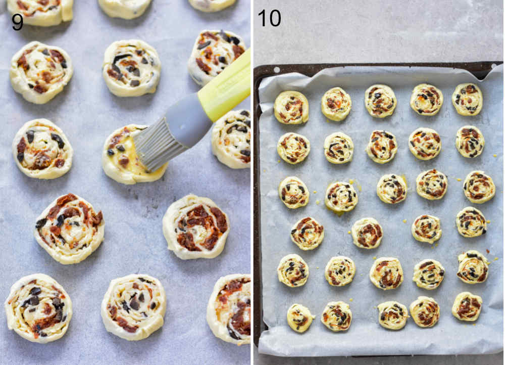 Puff pastry pinwheels are being brushed with egg wash. Puff pastry pinwheels on a parchement paper-lined baking sheet.