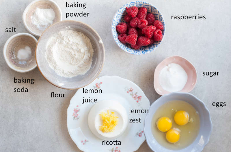 Labeled ingredients for lemon ricotta pancakes with raspberries.