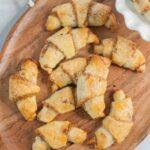 Rogaliki cookies on a chopping board.