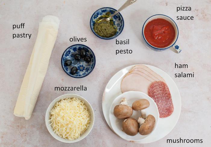 Labeled ingredients needed for puff pastry pizza bites.