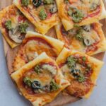Puff pastry pizza bites pinnable image.