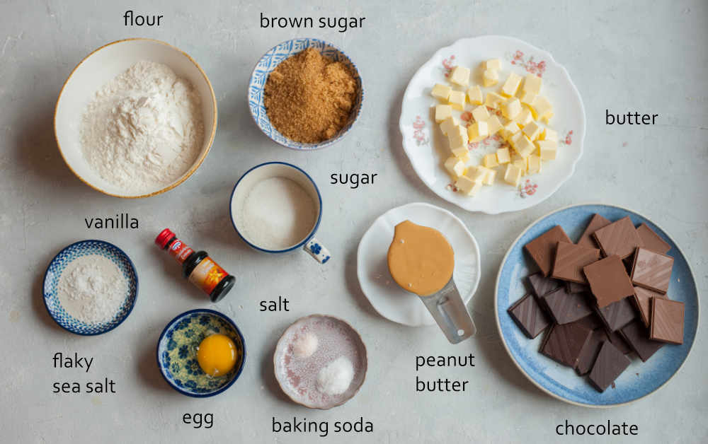 Labeled ingredients needed to prepare chocolate chunk peanut butter cookies.