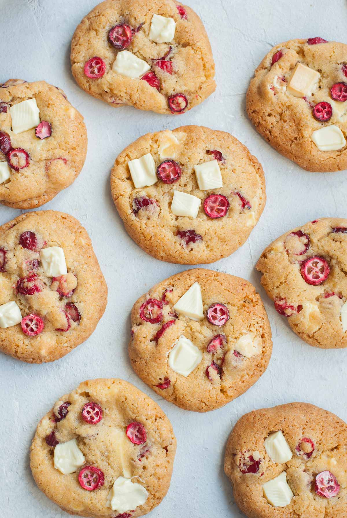 Fresh cranberry white chocolate cookies on a table.