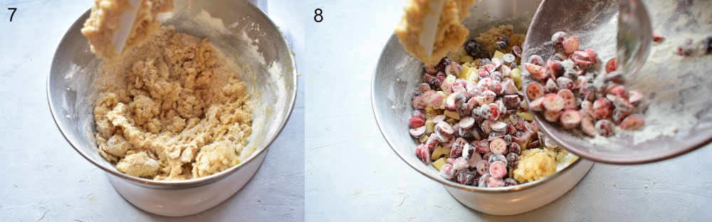 Cookie dough in a bowl. Cranberries and white chocolate are being added to the cookie dough in a bowl.