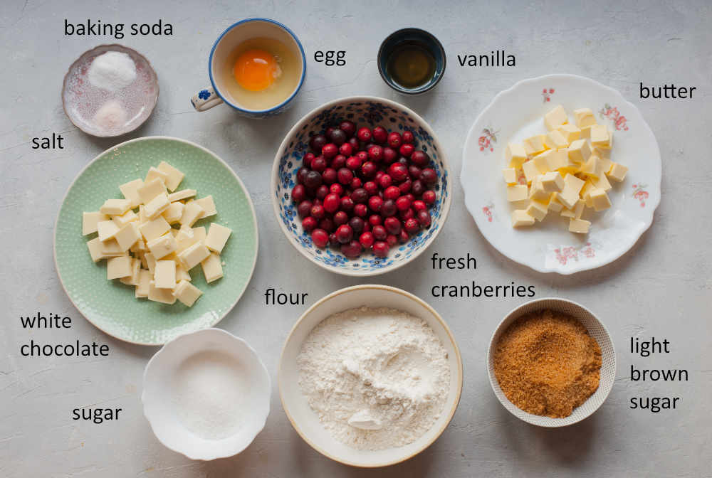 Labeled ingredients needed to prepare cranberry white chocolate cookies.