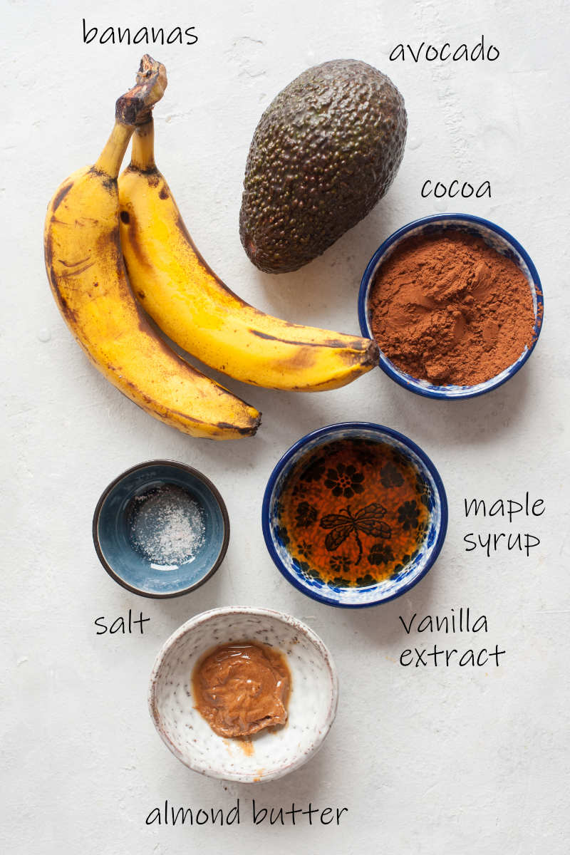 Labeled ingredients needed to prepare healthy chocolate pudding.