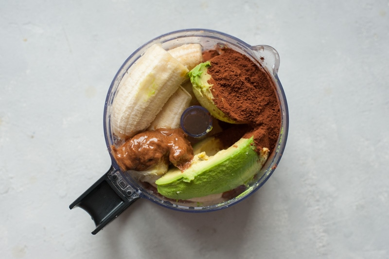 Ingreadients for cocoa pudding in a food processor container.
