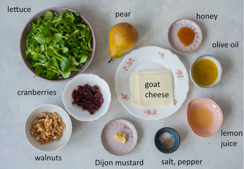 Labeled ingredients needed to prepare pear walnut salad.