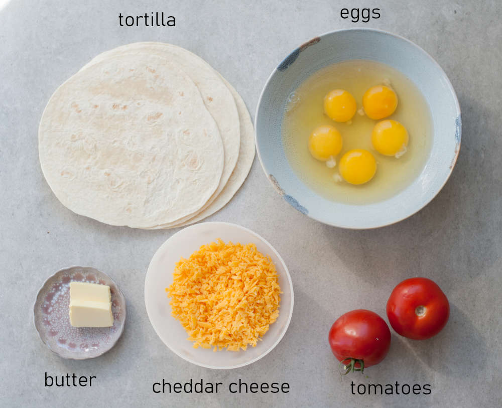 Labeled ingredients for breakfast quesadillas.