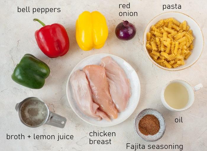 Labeled ingredients for chicken fajita pasta.