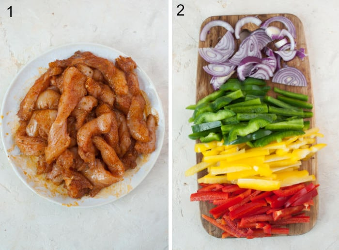 Chicken strips with spices in a bowl. Chopped bell peppers and onion on a chopping board.