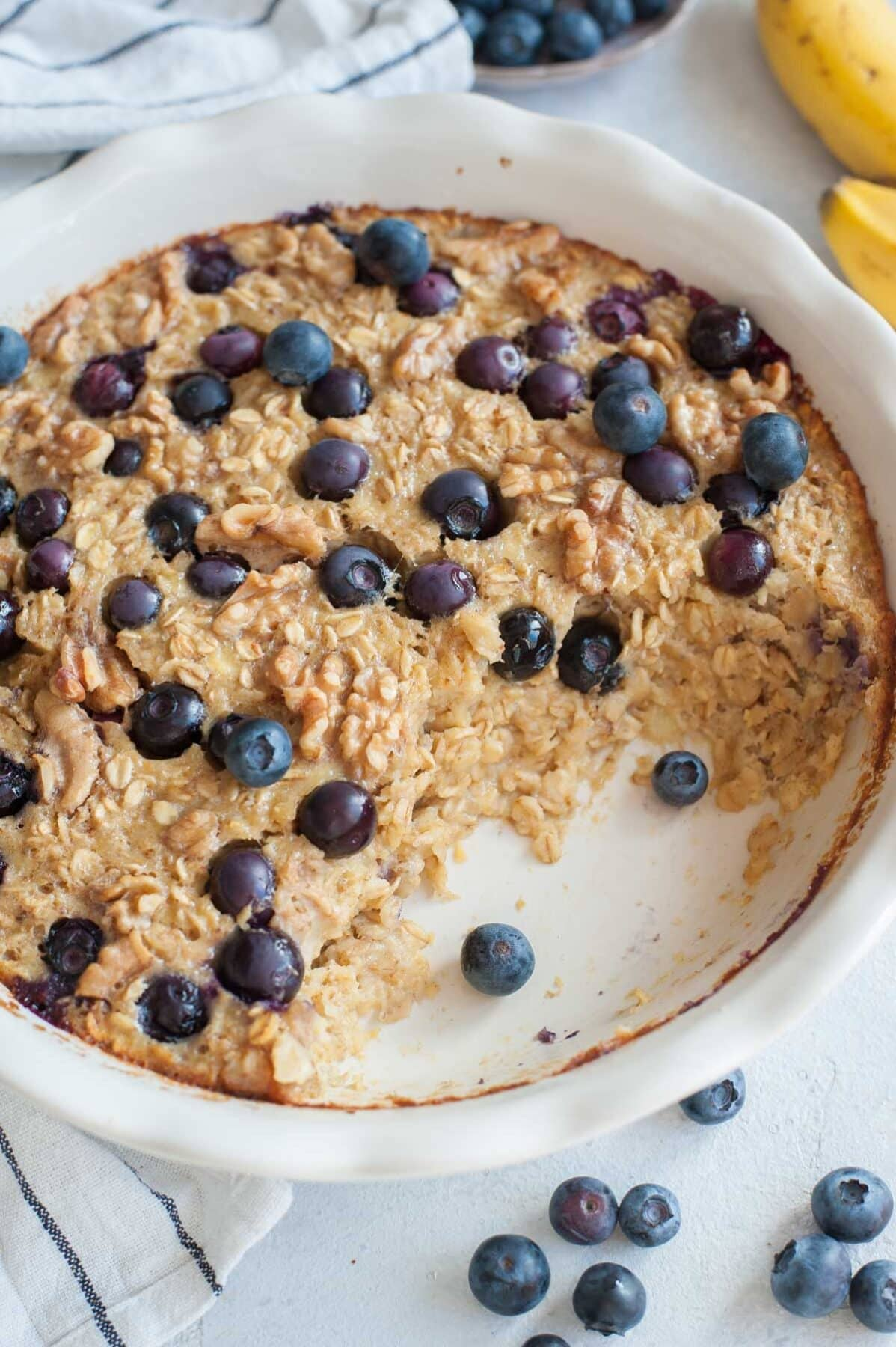 Banana Blueberry baked oatmeal in a white bowl.