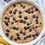 Banana blueberry baked oatmeal in a white baking dish.