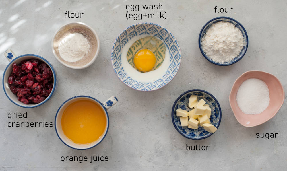 Labeled ingredients for crumble, egg wash and cranberries for the brioche dough.