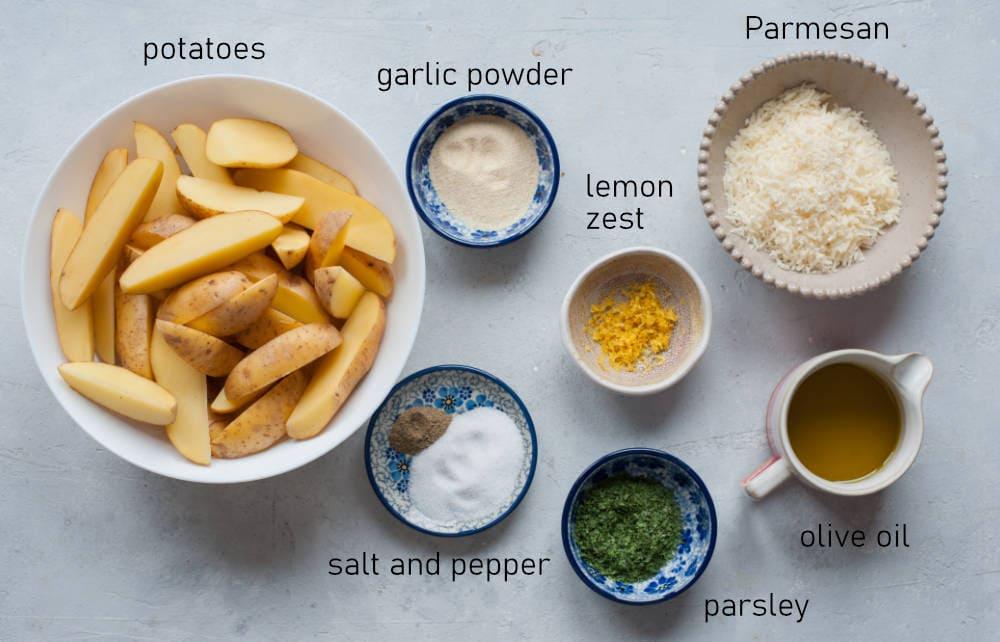 Labeled ingredients for parmesan lemon parsley potato wedges.