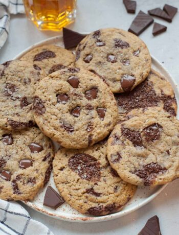 Rye chocolate chip cookies on a white plate.