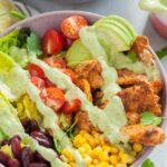 Southwest chicken salad in a violet bowl.