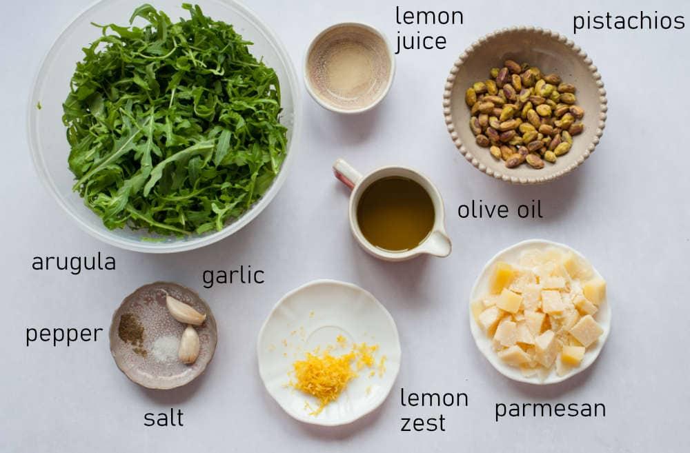 Labeled ingredients for arugula pistachio pesto.