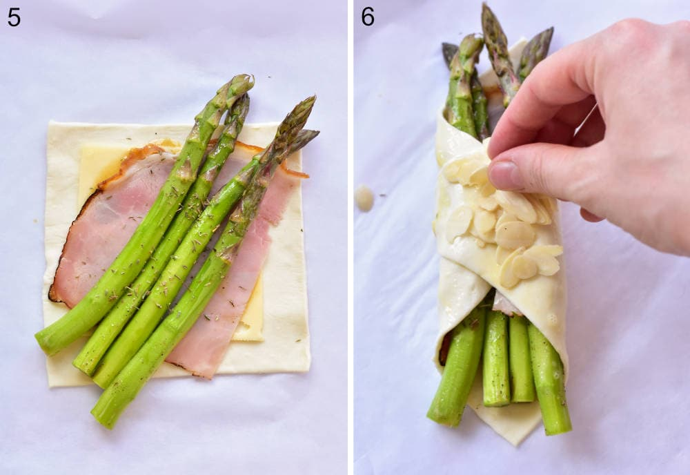 A piece of puff pastry with ham, cheese, and asparagus on top. Puff pastry appetizer is being sprinkled with flaked almonds.