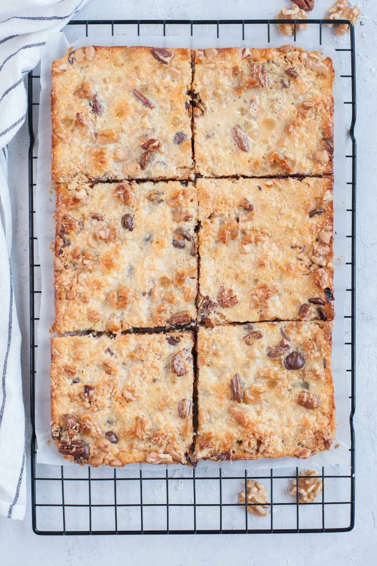 7-layer magic bars divided into squares on a cooling rack.