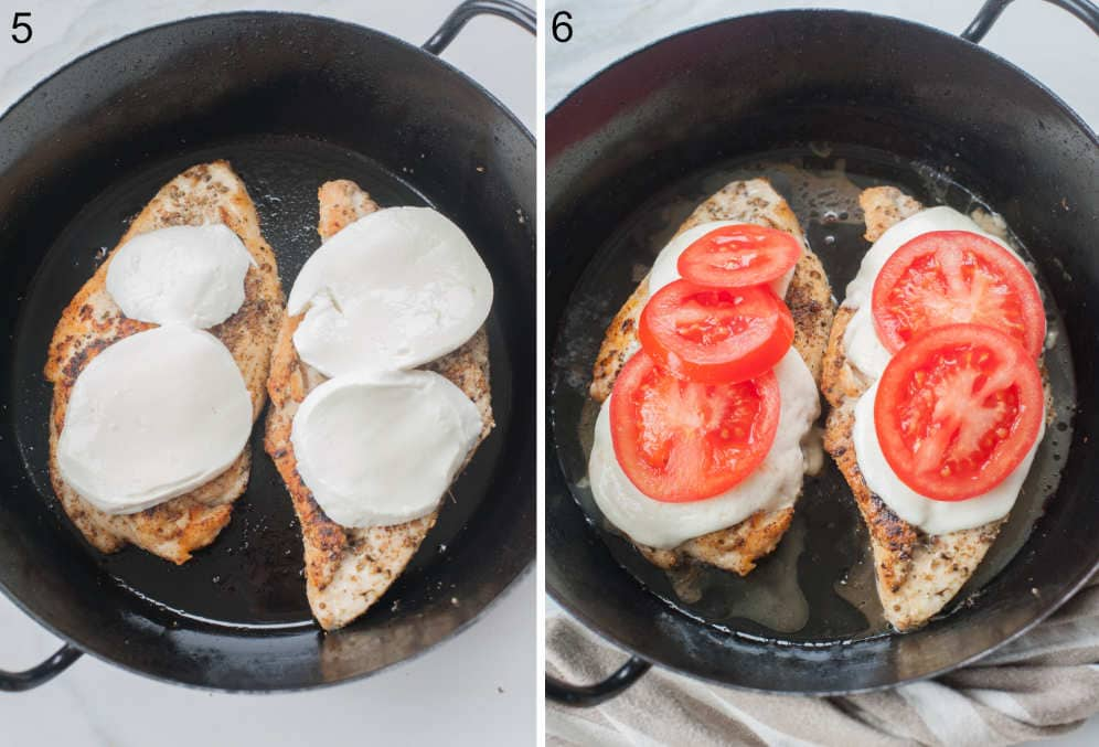 Seared chicken in a black pan topped with mozzarella cheese and tomato slices.
