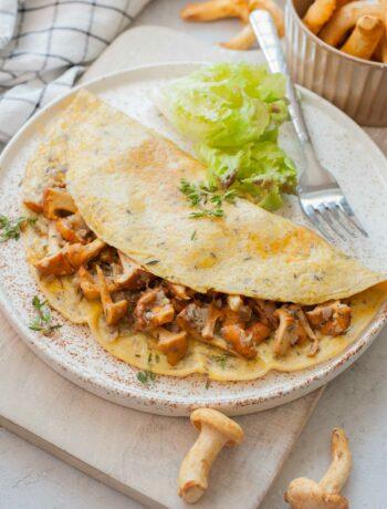 Chanterelle mushroom omelette on a white plate.