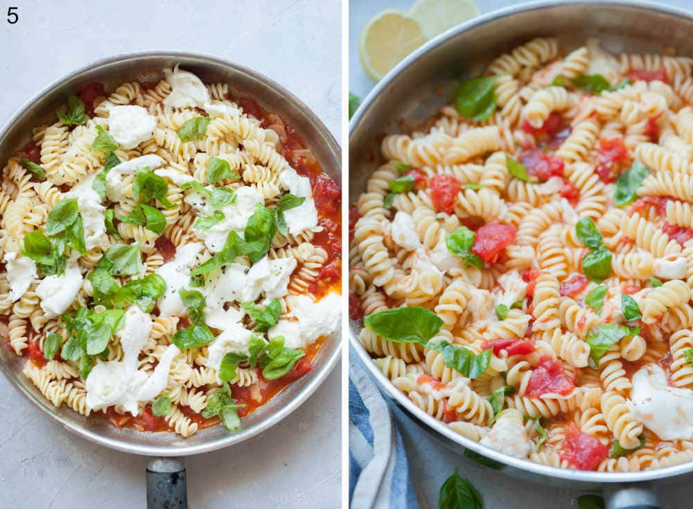 Pasta with tomato sauce, torn mozzarella and basil leaves in a frying pan.
