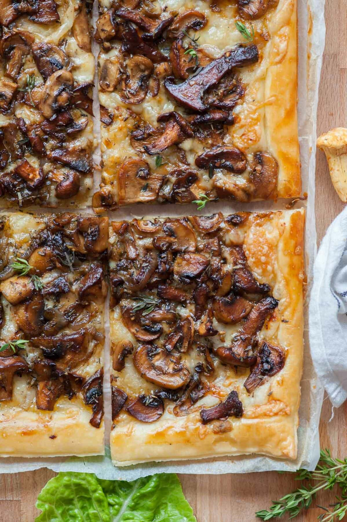 A close up picture of puff pastry mushroom tart.