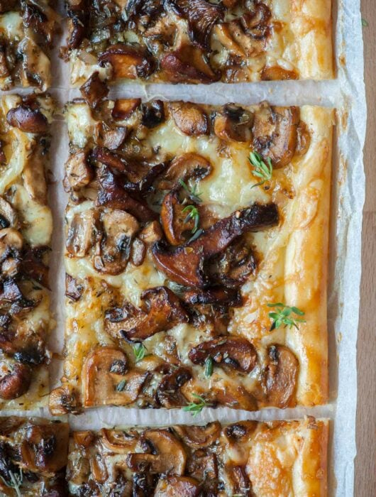 A close up photo of puff pastry mushroom tart.