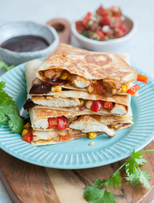 Bbq chicken quesadillas on a blue plate.