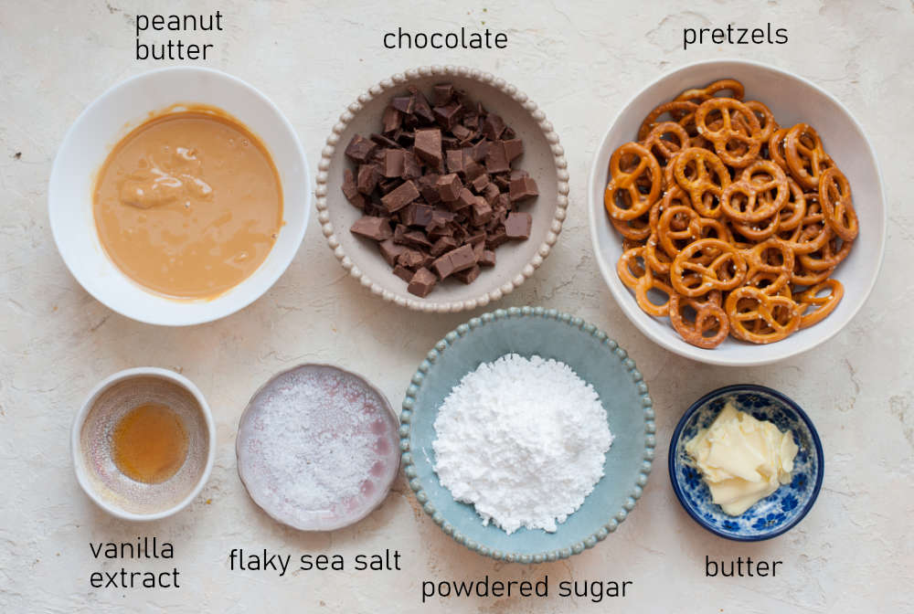 Labeled ingredients needed to prepare chocolate peanut butter pretzels.