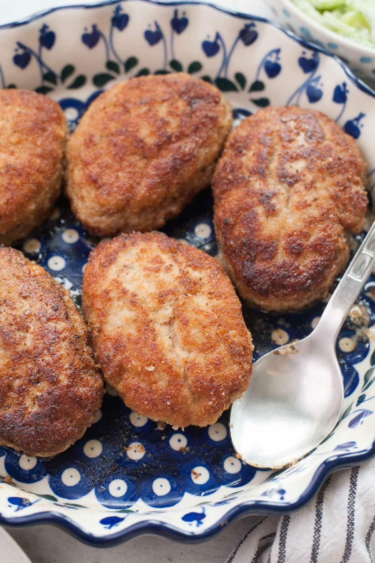 Kotlety mielone (Polish meat patties) in a white-blue baking dish.