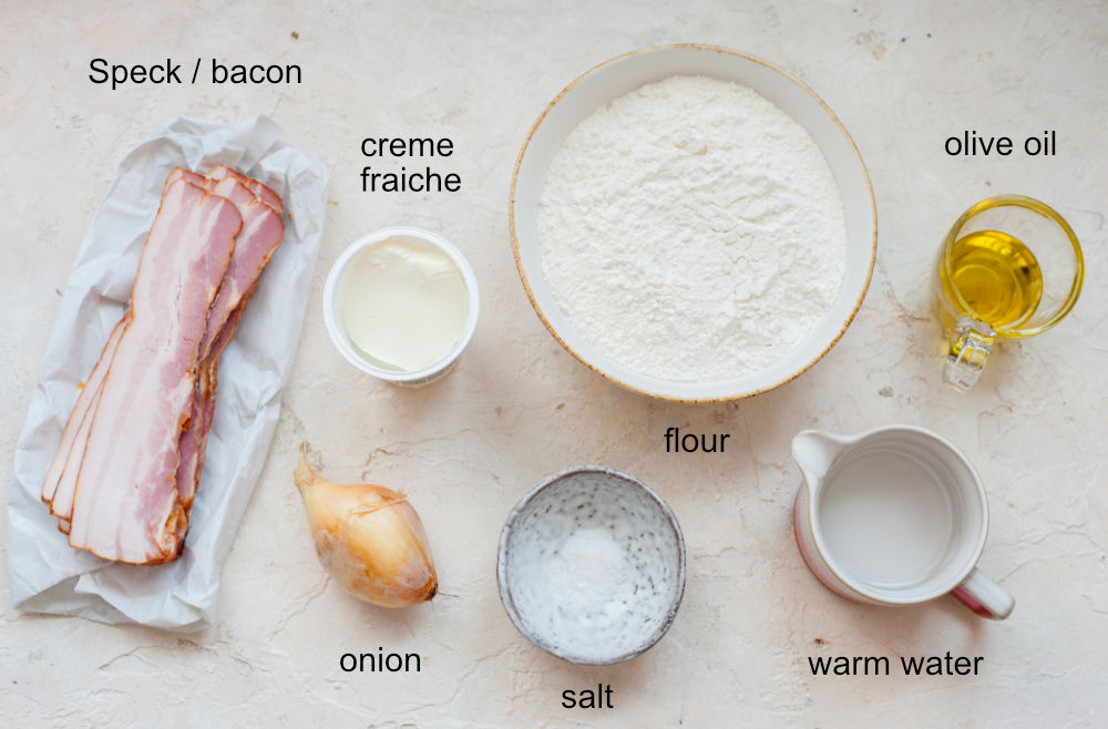 Labeled ingredients needed to prepare Flammkuchen.