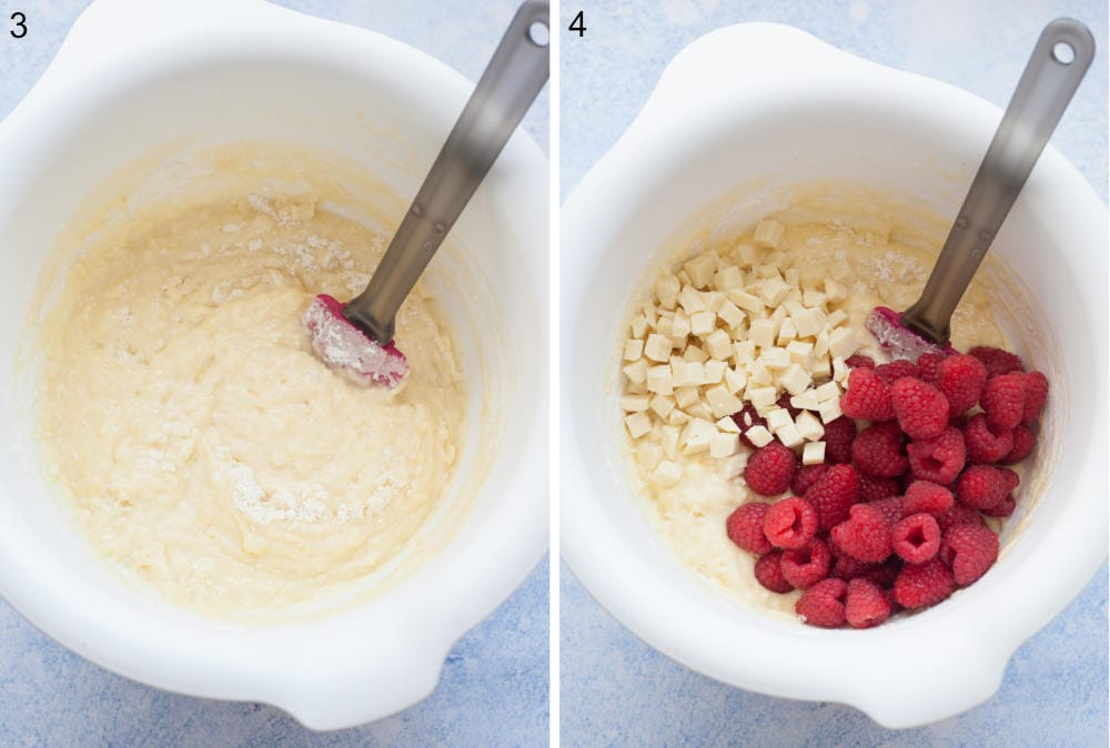 Muffin batter in a white bowl. Muffin batter with white chocolate chunks and raspberries in a bowl.