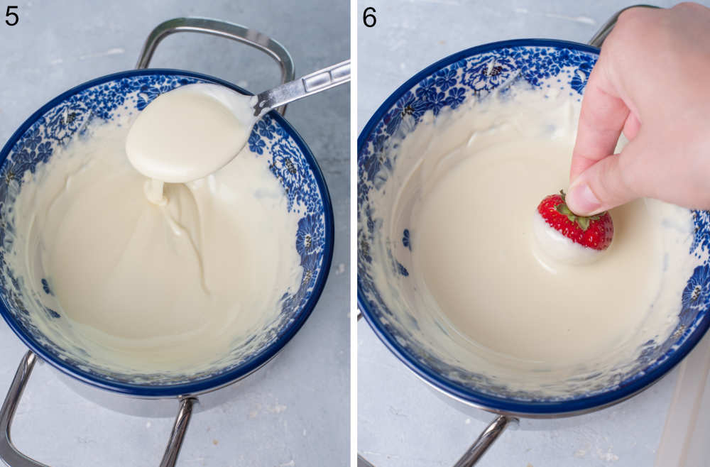 Melted white chocolate in a bowl. A strawberry is being dipped into melted white chocolate.