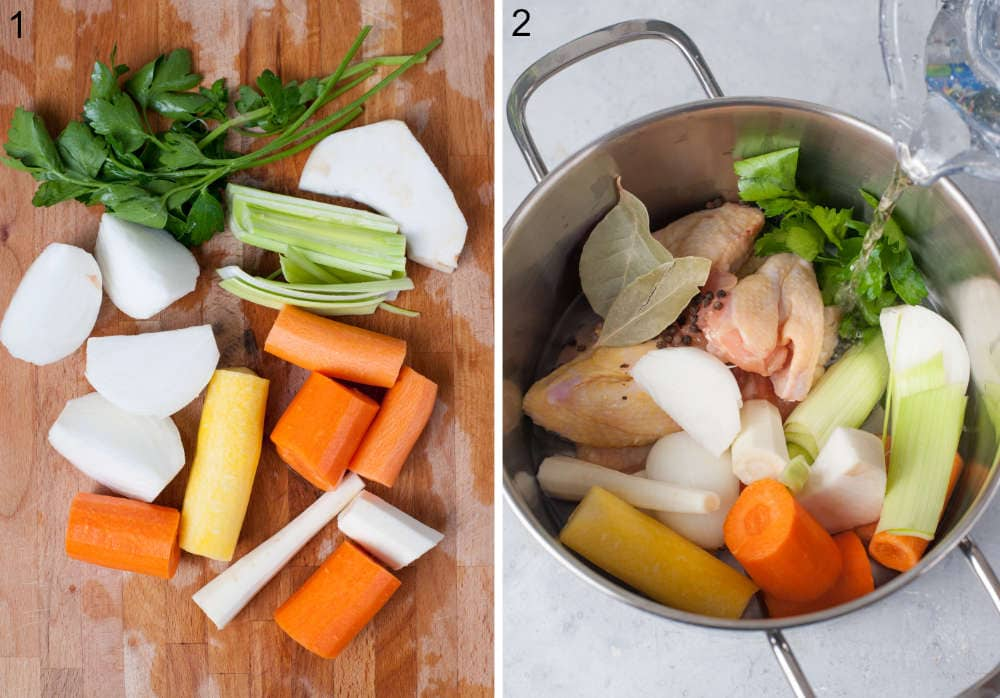 Chopped vegetables on a wooden board. Water is being added to a pot with vegetables and chicken.