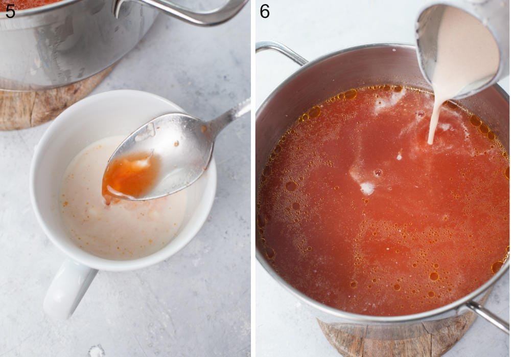 Cream is being tempered in a cup. Tempered cream is being added to a pot with tomato soup.