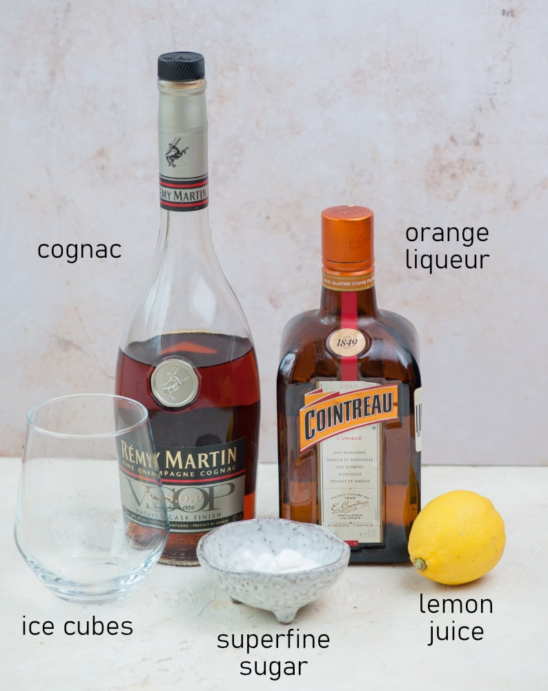 Labeled ingredients needed to prepare a sidecar cocktail.