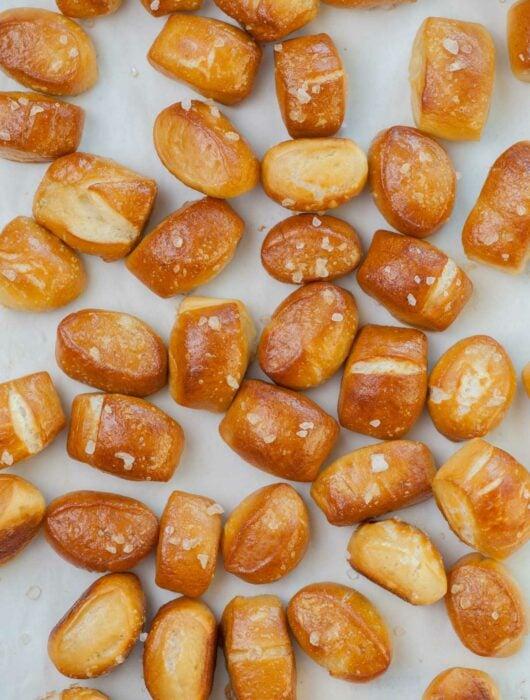 Soft pretzel bites on a piece of parchment paper.